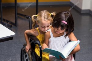 Two girls sitting in wheel chair